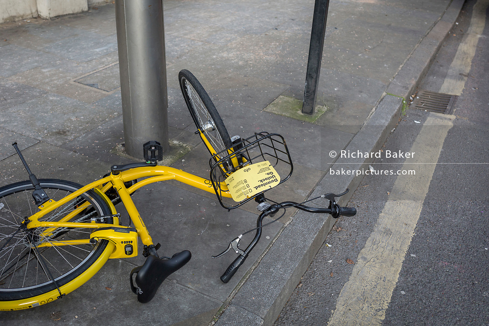 A fallen Ofo dockless hired bike lies on the pavement in Herne Hill, on 26th February 2018, in south London, England.