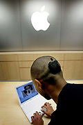 Staff member with an Apple logo hair cut at the Apple Store on Regent Street, London. This is Apple's flagship store in the UK. At the time this was the first such store in Europe, the others being in the United States and Japan.