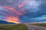 The sun sets along CO 69 in the Wet Mountain Valley.
