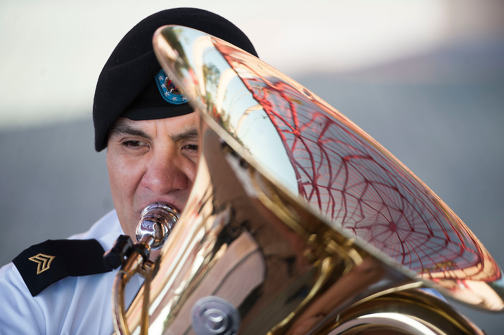 Eric Villalobos plays with the 300th Army Band under the big hats before the Angels' 7-2 victory against the Houston Astros Friday night at Angel Stadium. <br /> <br /> ///ADDITIONAL INFO:   <br /> <br /> angels.0528.kjs  ---  Photo by KEVIN SULLIVAN / Orange County Register  -- 5/27/16<br /> <br /> The Los Angeles Angels take on the Houston Astros Friday at Angel Stadium.