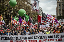 May 1, 2017 - Barcelona, Catalonia, Spain - Thousands of demonstrators with their waving banners march behind their banner during a manifestation organized by the mayor unions CC.OO and UGT, to protest the Troika, the austerity measures and the government under the slogan. (Credit Image: © Matthias Oesterle via ZUMA Wire)