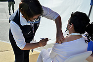 MEXICO CITY, MEXICO - DECEMBER 30: A nurse administrates the Pfizer-BioNTech COVID-19 vaccine to a person during the vaccinations against Covid for health workers at tents installed for the  vaccination campaign of Covid-19 inside Military Camp 1A on December 30, 2020 in Mexico City, Mexico (Photo by Carlos Tischler / Eyepix Group/Speed Media)