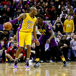 Feb 4, 2016; New Orleans, LA, USA; Los Angeles Lakers forward Kobe Bryant (24) is defended by New Orleans Pelicans guard Jrue Holiday (11) during a game at the Smoothie King Center. The Lakers defeated the Pelicans 99-96. Mandatory Credit: Derick E. Hingle-USA TODAY Sports