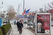 Nov. 24, 2014 - Gjilan, Kosovo - Pedestrians walk aside a banner on Monday, November 24, 2014, which is noting the visit of Ilir Meta in Gjilan. The five months political crisis after June Elections sunken the country's society into an abyss, dozens of hundred of ethnic Albanians from Kosovo, are leaving the country as in the back time of Milosevic era, when the then Yugoslavia wanted to deport the country, looking for a greater Serbia, without Albanians. Kosovo is the poorest country in Europe with over 50% of unemployment rate and millionaire politicians immersed in crime. Albanian Assembly speaker Ilir Meta is about to visit the Kosovo's south-eastern city of Gjilan. This visit is happening four days ahead of the 102nd anniversary of the declaration of the independence of Albania on November 28th, 1912. (Credit Image: © Vedat Xhymshiti/ZUMA Wire)