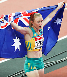 London, August 12 2017 . Sally Pearson, Australia, celebrates her gold medal in the  women's 100m hurdles final on day nine of the IAAF London 2017 world Championships at the London Stadium. © Paul Davey.