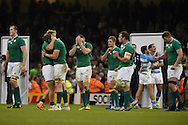 Ireland players look on dejected at end of the match. Rugby World Cup 2015 quarter-final match, Ireland v Argentina at the Millennium Stadium in Cardiff, South Wales  on Sunday 18th October 2015.<br /> pic by  Andrew Orchard, Andrew Orchard sports photography.