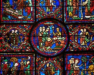 Medieval Windows of the Gothic Cathedral of Chartres, France, dedicated to St Martin of Tour.    A UNESCO World Heritage Site. In the  central oval panel St Martin is ordained Bishop of Tour. .<br /> <br /> Visit our MEDIEVAL ART PHOTO COLLECTIONS for more   photos  to download or buy as prints https://funkystock.photoshelter.com/gallery-collection/Medieval-Middle-Ages-Art-Artefacts-Antiquities-Pictures-Images-of/C0000YpKXiAHnG2k