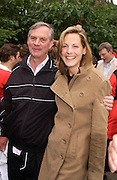 Lord Astor and Camilla Astor, Lords v Commons tug-o-war in aid of Macmillan Cancer Relief,  Westminster. 22 June 2004. ONE TIME USE ONLY - DO NOT ARCHIVE  © Copyright Photograph by Dafydd Jones 66 Stockwell Park Rd. London SW9 0DA Tel 020 7733 0108 www.dafjones.com