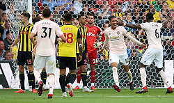 Manchester United's Chris Smalling (second right) celebrates scoring his side's second goal of the game with team-mate PAul Pogba (right) during the Premier League match at Vicarage Road, Watford