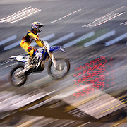 A blur of motion as Jeremy Martin, Yamaha, flies through the air during the Monster Energy AMA Supercross series held at MetLife Stadium. 62,217 fans attended the event held for the first time at MetLife Stadium, New Jersey, USA. 26th April 2014. Photo Tim Clayton