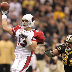 16 January 2010: Arizona Cardinals quarterback Kurt Warner (13) throws a pass as New Orleans Saints defensive end Will Smith (91) provides pressure during a 45-14 win by the New Orleans Saints over the Arizona Cardinals in a 2010 NFC Divisional Playoff game at the Louisiana Superdome in New Orleans, Louisiana.