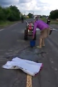 "German man travels to Thailand just to repair potholes (he wasn't asked to)<br /> <br /> A German resident in Buriram was photographed repairing potholes on a road after the giant holes have caused many accidents in his beloved community.<br /> <br /> Peter Groman, 76, and his wife Kusuma Ngamwong, 51, reportedly joined the locals in Sa Kaeo district to fix the damaged road. Photos of the farang man fixing a Thai road went viral and have drawn praise from netizens.<br /> <br /> His wife, who posted Groman's photos on her Facebook wrote: ""He came to live in our home country. He's willing to help us Thais. Today, Mr. Peter helped close the potholes in the middle of Luang road that had caused many accidents in the past. Neighbors have been worried that it would cause even more danger.""<br /> <br /> Groman, who has lived in Buriram with his Thai wife for five years, told Thai News Agency that he feels happy to help increase safety for motorists, and he will continue doing good to help society.<br /> <br /> Groman's inspiration to give back to the community is his wife, Kusuma, who has been volunteering at a local hospital. Together the couple have been helping the community for the past four years without asking for anything in return.<br /> <br /> Meanwhile, Wit Worawong, director of Buriram's Department of Rural Roads, said that he was touched to see the foreigner's kindness. However, he asks that locals should report to the department.<br /> <br /> The government has enough funds to help, according to them.<br /> ©Exclusivepix Media"