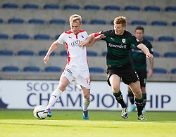 Falkirk's Craig Sibbald and Raith Rovers Jason Thomson.<br /> Raith Rovers 0 v 0 Falkirk, Scottish Championship game played 27/9/2014 at Raith Rovers Stark Park.