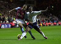 Fotball<br /> Premier League England 2004/2005<br /> Foto: SBI/Digitalsport<br /> NORWAY ONLY<br /> <br /> 22.11.2004<br /> <br /> Aston Villa v Tottenham Hotspur<br /> FA Barclays Premiership, Villa Park<br /> <br /> Villa's Luke Moore (L) is brought down by Noe Pamarot