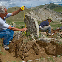 A Smithsonian Museum archaeology team studies a 2700+ year-old,  khirigsur burial mound above Delger River, near Muren, Mongolia.