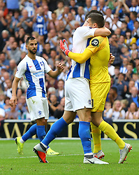 Brighton & Hove Albion goalkeeper Mathew Ryan (right) celebrates saving an attempt on goal with Shane Duffy (left) during the Premier League match at the AMEX Stadium, Brighton.