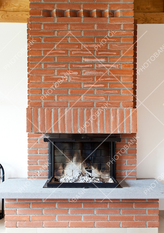 Modern brick fireplace, indoors, is off