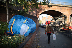 © Licensed to London News Pictures . 24/10/2018. Leeds , UK . An empty tent sits amongst ivy adjacent to Penny Pocket Park in Leeds City Centre . At least six people sleeping rough have died in the Metropolitan Borough of the City of Leeds since March 2017 and West Yorkshire Police say they responded to 66 reported cases of people suffering the effects of Spice in July 2018 , a large increase on previous months . Photo credit : Joel Goodman/LNP