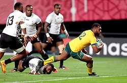 Australia's Samu Kerevi scores his fifth try of the match during the 2019 Rugby World Cup Pool D match at Sapporo Dome.