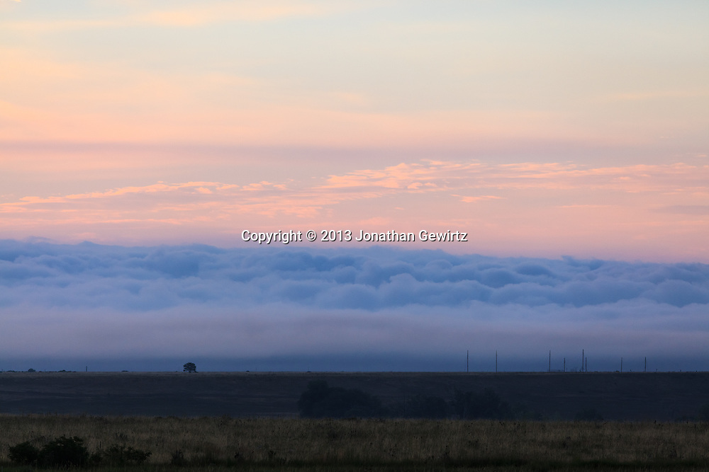 Fog banks over Boulder, Colorado open space, to the east of the Front Range, around sunrise. WATERMARKS WILL NOT APPEAR ON PRINTS OR LICENSED IMAGES.