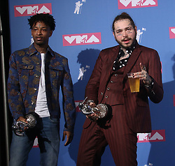 August 20, 2018 - New York City, New York, U.S. - Hip hop artists 21 SAVAGE and POST MALONE pose for photos in the press room for the 2018 MTV 'VMAS' held at Radio City Music Hall. (Credit Image: © Nancy Kaszerman via ZUMA Wire)