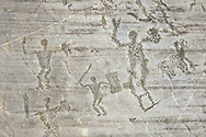Petroglyph, rock carving, of warriors with swords and shileds. Carved by the ancient Camuni people in the iron age between 1000-1600 BC. Rock no 24,  Foppi di Nadro, Riserva Naturale Incisioni Rupestri di Ceto, Cimbergo e Paspardo, Capo di Ponti, Valcamonica (Val Camonica), Lombardy plain, Italy .<br /> <br /> Visit our PREHISTORY PHOTO COLLECTIONS for more   photos  to download or buy as prints https://funkystock.photoshelter.com/gallery-collection/Prehistoric-Neolithic-Sites-Art-Artefacts-Pictures-Photos/C0000tfxw63zrUT4<br /> If you prefer to buy from our ALAMY PHOTO LIBRARY  Collection visit : https://www.alamy.com/portfolio/paul-williams-funkystock/valcamonica-rock-art.html