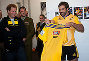 Hurricanes captain Conrad Smith presents Prince Harry with a personalised jersey in the Hurricanes changing rooms after the Super Rugby match between the Hurricanes and Sharks at Westpac Stadium, Wellington, New Zealand on Saturday, 9 May 2015. Photo: Dave Lintott / lintottphoto.co.nz