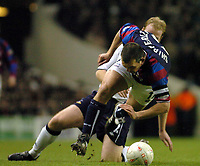 Picture: Henry Browne.<br /> Date: 03/01/2004.<br /> Tottenham Hotspur v Crystal Palace FA Cup 3rd Round.<br /> Neil Shipperly is sent flying by Spurs' Gary Doherty who gets booked.