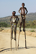 Africa, Ethiopia, Konso tribe children on stilts