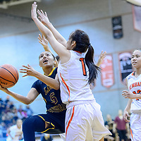 Tohatchi Cougar Kalian Mitchell (5) attempts a layup around Gallup Bengal Ashley Antone (1) at Gallup High School Tuesday.