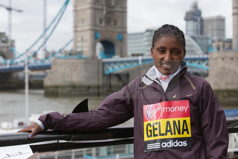 © Licensed to London News Pictures. 18/04/2013. London, England. Pictured: Ethiopian runner Tiki Gelana, gold medal at the 2012 London Olympics. Virgin London Marathon - Photocall with International Women Runners Athletes Tiki Gelana (ETH), Edna Kiplagat (KEN), Priscah Jeptoo (KEN) and Yoko Shibui (JPN) at Tower Bridge ahead of Sunday's run, London. Photo credit: Bettina Strenske/LNP