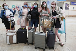 © Licensed to London News Pictures. 08/06/2021.Doncaster, UK. Berty Jones, Beth Green, Carol Smith, Georgia Williams and Brion Wilson from Sheffield arrived at 3am from Faro at Doncaster Sheffield airport ahead of the 4am implementation of quarantine rules. From 4am on Tuesday 8 June, Portugal will be removed from the Green list and added to the Amber list. Photo credit: Ioannis Alexopoulos/LNP