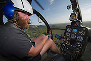 Elephant capture aerial<br /> Aerial view of elephants from Hughes 500 helicopter to be darted for relocation.<br /> Zimbabwe
