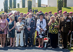 © Licensed to London News Pictures. 10/06/2015. Alrewas, UK.  Military personnel along with friends and families of those killed in Afghanistan attend a Service of Dedication to inaugurate the Bastion Memorial, for those who lost their lives during combat operations in Afghanistan.  Over 2000 guests attended the ceremony.   Photo credit : Alison Baskerville/LNP