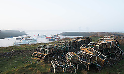 © Licensed to London News Pictures. 13/03/2014<br /> <br /> South Gare, Teesside, England, UK<br /> <br /> Lobster pots are stacked up at a small fishing community at Paddy's Hole on South Gare at the mouth of the River Tees on Teesside.<br /> <br /> Photo credit : Ian Forsyth/LNP