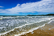 Surf and sand at Moeraki Beach, Moeraki, Otago, South Island, New Zealand