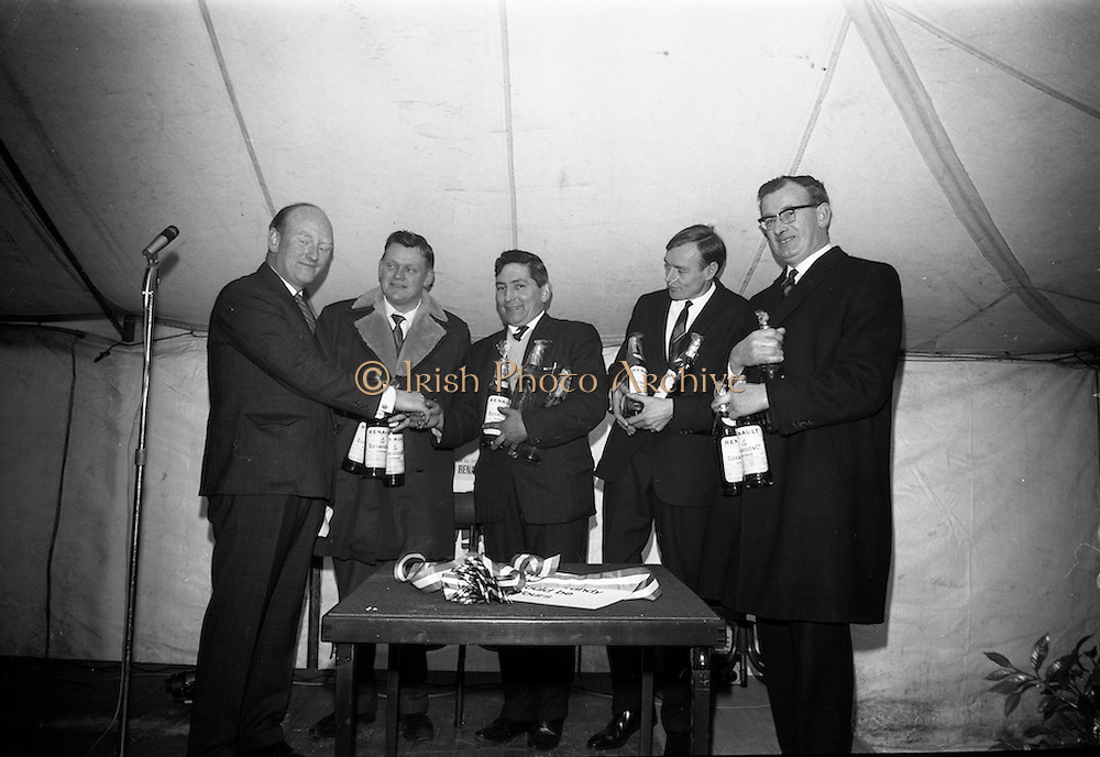 17/3/1966<br /> 3/17/1966<br /> 17 March 1966<br /> <br /> Winners of the 4L Economy Test receiving their prize<br /> <br /> Mr. Kilroy, Mr. Johnson, Mr. Cornane, Mr. O'Bryne and Mr. Roéche