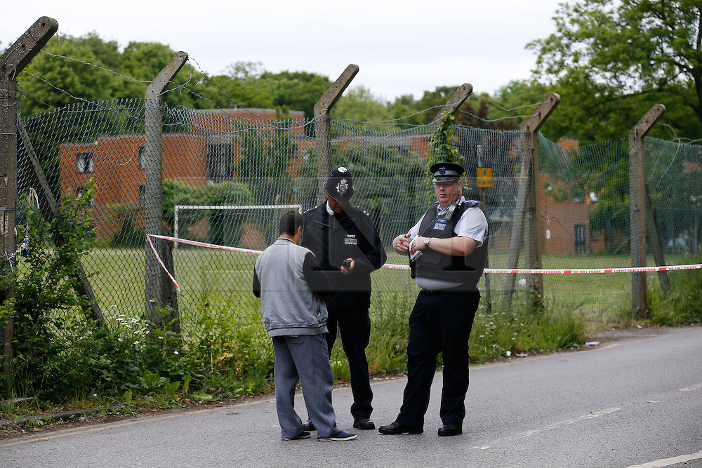 © Licensed to London News Pictures. 09/06/2013, London, UK.  Police officers stand guard at a road leading to the Darululoom Islamic boarding school in Chislehurst, southeast London where a 'suspicious' fire broke out, Sunday, June 9, 2013. Photo credit : Sang Tan/LNP
