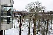© Licensed to London News Pictures. 19/01/2013. Kew, UK People take in the view from the Treetop walkway. People enjoy the snow at Kew Gardens in West London today 19th January 2013. More cold weather and snow are expected over the coming days.  Photo credit : Stephen Simpson/LNP