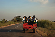 Kids take a ride from school, somewhere along the road between Yangon and Dawei, Burma.<br /> Note: These images are not distributed or sold in Portugal