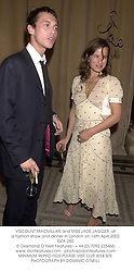 VISCOUNT MACMILLAN and MISS JADE JAGGER, at a fashion show and dinner in London on 16th April 2002.OZA 280