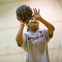 060613       Adron Gardner\Independent<br /> <br /> Sarah Begay lines up a shot during the girls and boys basketball camp at Gallup High School in Gallup Thursday.