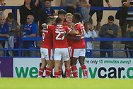 GOAL Kieffer Moore is congratulated after scoring 0-2  during the EFL Sky Bet League 1 match between Rochdale and Barnsley at Spotland, Rochdale, England on 21 August 2018.