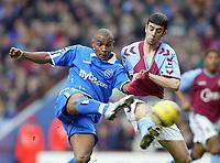 Fotball<br /> Premier League 2004/05<br /> Aston Villa v Birmingham<br /> Villa Park<br /> 12. desember 2004<br /> Foto: Digitalsport<br /> NORWAY ONLY<br /> Birmingham City's Clinton Morrison, with a big handful of Aston Villa's Mark Delaney's shirt, scores the opening goal