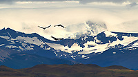 Three Andean Condors Soaring in Patagonia. Torres del Paine National Park, Chile. Image taken with a Nikon D3s and 70-300 mm VR lens (ISO 200, 300 mm, f/14, 1/800 sec).