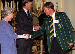 The Queen shakes hands with South African cricketer Jonty Rhodes during a reception at Buckingham Palace in London for the World Cup cricket teams.