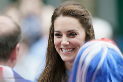 © Licensed to London News Pictures. 12/06/2016. Britain's Kate, Duchess of Cambridge laughs as he meets the crowd during the Patron's Lunch. As part of the celebrations for Queen Elizabeth II's 90th birthday it is a street party celebrating The Queen's patronage of charities and organisations.  Photo credit: Tim Ireland/LNP