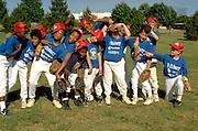 12 year old inner city baseball team goofing off during practice.  St Paul  Minnesota USA