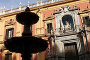 The silhouette of a fountain outside the Catedral de Malaga on Plaza del Obispo, Malaga, Spain