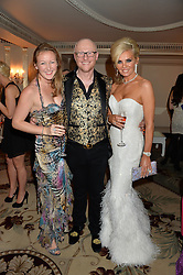Left to right, REBEKAH CAUDWELL, her father JOHN CAUDWELL and CLAIRE CAUDWELL at a birthday dinner for Claire Caudwell for family & friends held at The Dorchester, Park Lane, London on 24th January 2014.